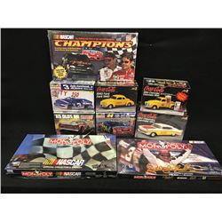 LOT OF RACING COLLECTABLES INC: 3 NASCAR MONOPOLY GAMES AND 6 MODEL CAR KITS