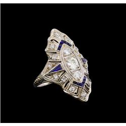 0.73 ctw Diamond and Sapphire Ring - Platinum