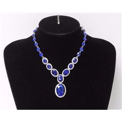 Ladies Custom Necklace with Sapphire blue Swarovski Elements = 182.40ct and CZ. SRRV: $480.00
