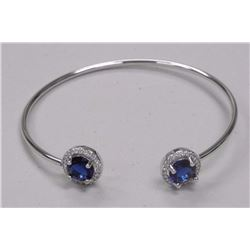 Ladies Custom Bangle Bracelet with 2 Sapphire Blue Swarovski Elements = 3.50cts and 40 Clear Around.