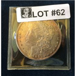 USA: 1885 Morgan Dollar Light Golden Tone over full Lustre