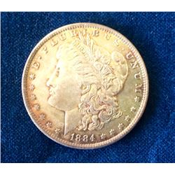USA: 1884 Morgan Dollar Light orange and red Tone Worth a Premium