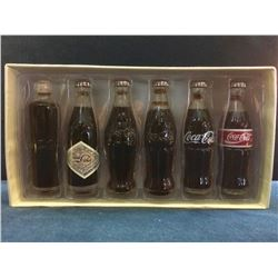 Coca-Cola Evolution of the Coca-Cola Contour Bottle lot of 6 Pce style-1899-1900-1915-1915-1957-1962