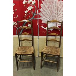 TWO ANTIQUE LADDER BACK CHAIRS WITH RUSH SEATS