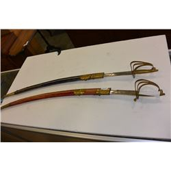 TWO CAVALRY SWORDS IN SHEATHS