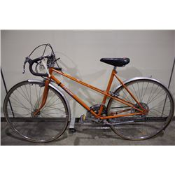 2 BIKES: ORANGE PREMIER TOUR BIKE & PINK VAGABOND MOUNTAIN BIKE