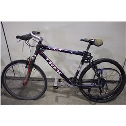 2 BIKES: PURPLE TREK FRONT SUSPENSION MOUNTAIN BIKE & RED RALEIGH KIDS BIKE