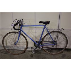 2 BIKES: BLUE RALEIGH TOUR BIKE & PURPLE ROAD RUNNER MOUNTAIN BIKE