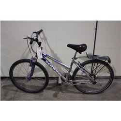 2 BIKES: PURPLE SCHWINN FRONT SUSPENSION HYBRID BIKE & ORANGE PREMIER TOUR BIKE