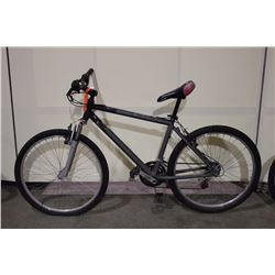 2 BIKES: GREY NO NAME FRONT SUSPENSION MOUNTAIN BIKE & BLACK TRIUMPH MOUNTAIN BIKE