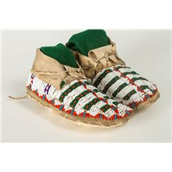 """Northern Plains Beaded Child's Moccasins. 6 ¼"""" long with fully beaded uppers."""