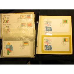 """1980-88 """"Flag-Series"""" United Nations First Day Covers with album, some in place, others not. All Min"""
