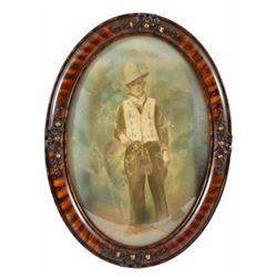 Cowboy Photograph In Dome Frame Hand tinted photo of a cowboy in a beaded vest wearing chaps, Colt &