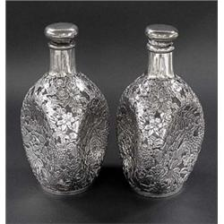FINE PAIR OF SILVER OVERLAY PINCHED GLASS DECANTERS, Japanese. 20th Century. Each heavily overl...