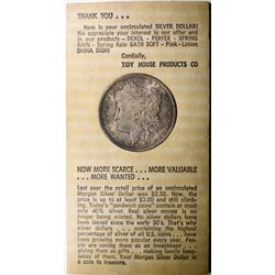 1884-O MORGAN SILVER DOLLAR TIDY HOUSE IN ORIGINAL HOLDER & ENVELOPE