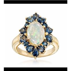 Ethiopian Opal and 2.00 ct. t.w. London Blue Topaz Ring in 14kt Gold Over Sterling. Size 6