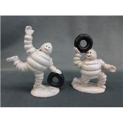 2 Cast iron Michelin Man figurines