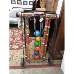 Vintage wood croquet set on stand