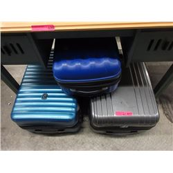 3 Assorted large rolling suitcases