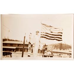 Woman Holding a Large American Flag in Truckee