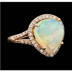 14KT Rose Gold 4.20ct Opal and Diamond Ring