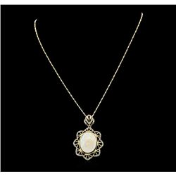 14KT Yellow Gold 7.65ct Opal and Diamond Pendant with Chain