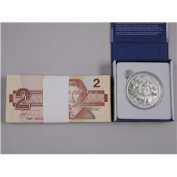 2015 - Coastal Waters .9999 Fine Silver $200.00 Coin and (100) Bank of Canada 1986 Two Dollar Notes.