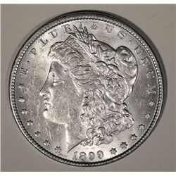 1899 MORGAN DOLLAR AU/BU RIM HIT BELOW DATE