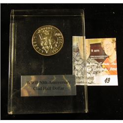 1991-1995 WW II 50th Anniversary Clad Half Dollar in Lucite box.