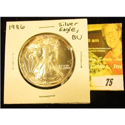 1986 U.S. American Eagle Silver Dollar, Brilliant Uncirculated with Gold highlights.