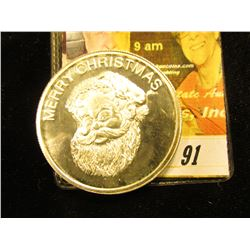 """Happy New Year G.S.M. One Oz. 999 Silver"", depicts a Snowman and Snowwoman & Santa Claus, minted by"
