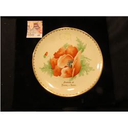 "7 1/2"" Saucer ""Souvenir of Dows, - Iowa."" depicts a flower in bloom."