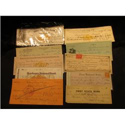 (10) Old Bank Checks dating back to the Civil War Era, some Revenue Stamps, most cancelled.