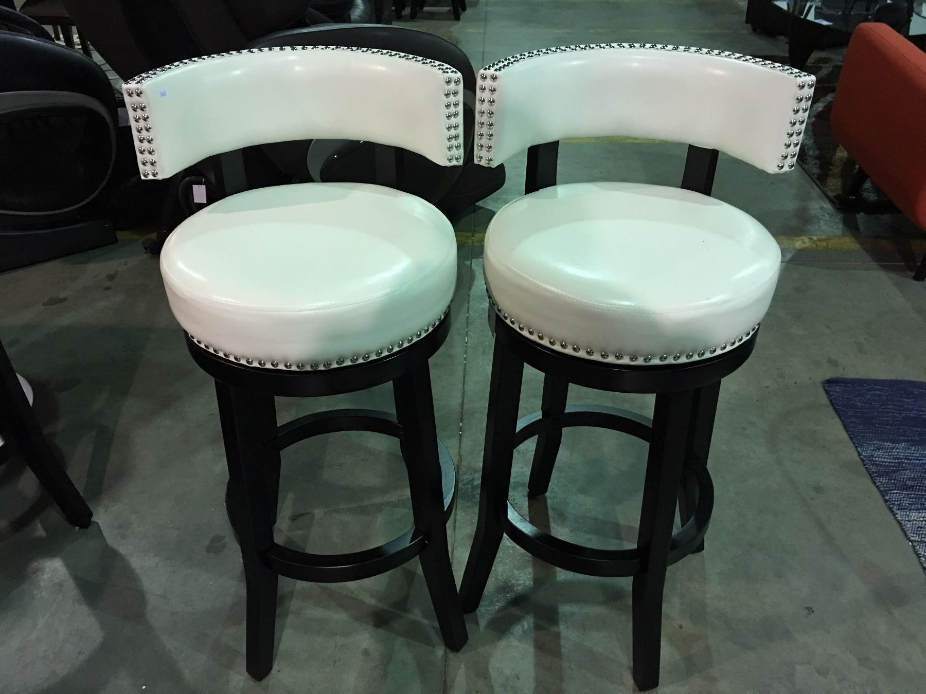 "PAIR OF WHITE LEATHER STUDDED UPHOLSTERED 29"" BARSTOOLS"