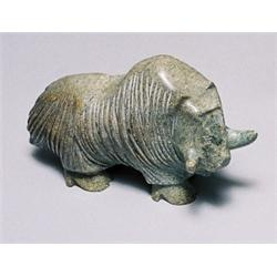 Johnny Pootoogoo, A pale green soapstone carving of a muskox, signed in roman and dated '91., L...