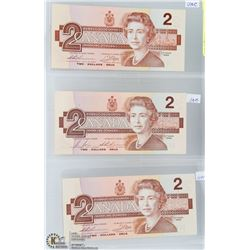 THREE 1986 UNCIRCULATED CANADIAN $2 BANK NOTES