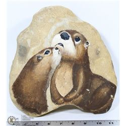 OTTERS PAINTED ON STONE