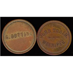 Lot of 2 Manitoba trade tokens.