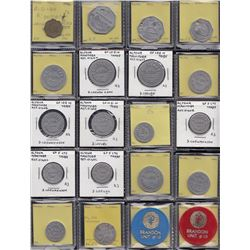 Lot of 28 Manitoba trade tokens.