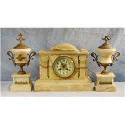 E. Keller marble mantle clock w/matching candle stick holders, brass trim