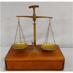 Gold scale with weights, appears complete