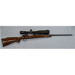 Rem 700 rifle, 300 Win Mag, Vortex 4-16 x 50 scope, engraved, checkered wood, s#E67805xx