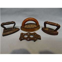 3 small sad irons w/1 trivet, 3 & 4""