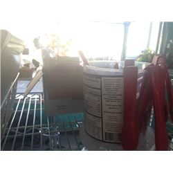 PLASTIC SPOONS AND RED TONGS IN BIN