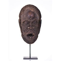 African Luluwa Wood Mask With Two Teeth Is On
