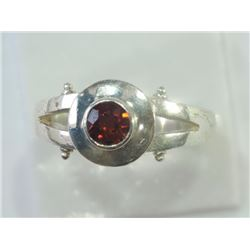 RING - ROUND FACETED GARNET IN STERLING SILVER SETTING - RETAIL ESTIMATE $200