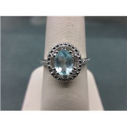RING - BLUE TOPAZ & DIAMOND IN STERLING SILVER SETTING - 1 CT OVAL FACETTED TOPAZ & 2 DIAMONDS - RET