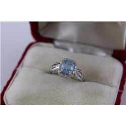 RING - 2CT BLUE AND 2 WHITE TOPAZ IN STERLING SILVER SOLITAIRE DESIGNED SETTING - RETAIL ESTIMATE $3