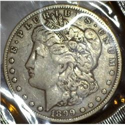 1899 O U.S. Morgan Silver Dollar in a Littleton Coin Company holder, Fine.
