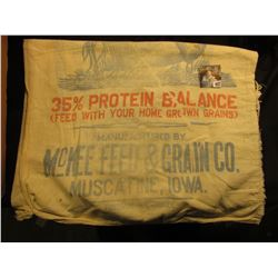 "100 Pound Cloth Sack ""Manufactured by McKee Feed & Grain Co. Muscatine, Iowa Mineralized Hog Supplem"